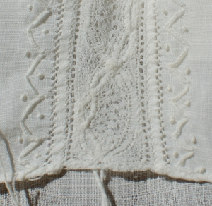 Closeup of lace insertion on cap.