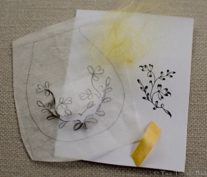 The pattern: traced, pricked, and pounced. The fluff of canary-colored silk is the remains of